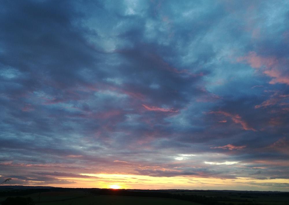 sunset at summer solstice, Badbury Rings